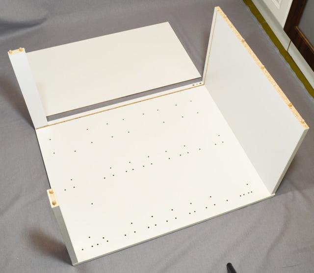 Laatikostokaapin kasaus